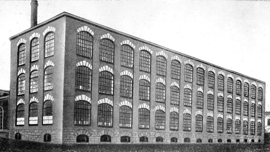 A modern three-floor factory building, with its design inspired by buildings he had seen in the USA